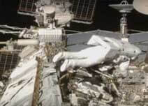 Spacewalk disconnects cables on mating adaptor ready for its move