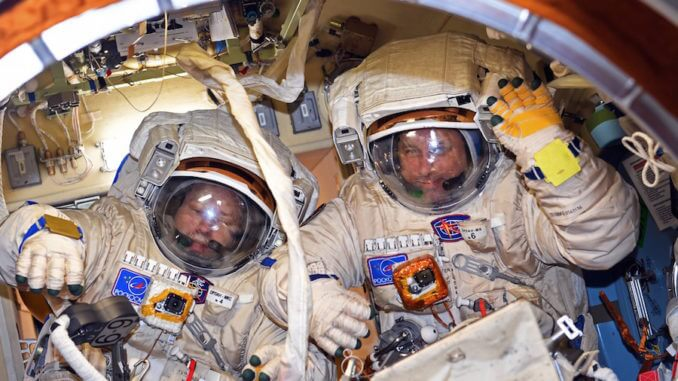 Russian spacewalkers make longer one than planned