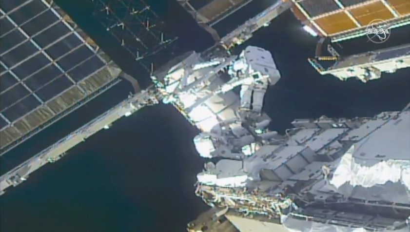Spacewalking astronauts attach brackets on ISS solar arrays ready for new ones