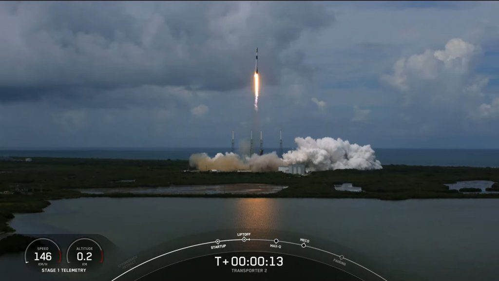The Falcon 9 rocket lifting-off carrying its multiple payloads into orbit